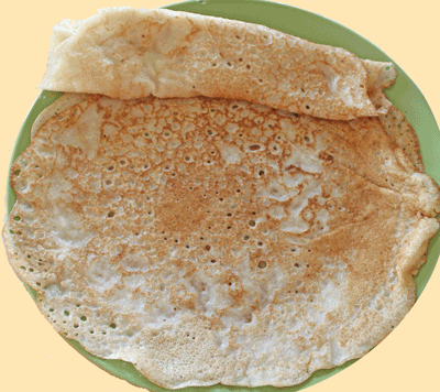 Appau/pancake just out of pan and ready to be eaten