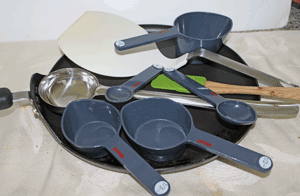 A non-stick pan, large spatula for lifting appau, small spatula to spread oil, a large ladle spoon that is used to scoop the batter, and measuring cups and spoons, handy tools for this recipe