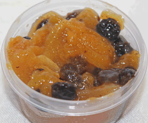 Stewed Fruit for topping crumpets. Dried apricots and raisins were microwaved with some water to soften the fruits